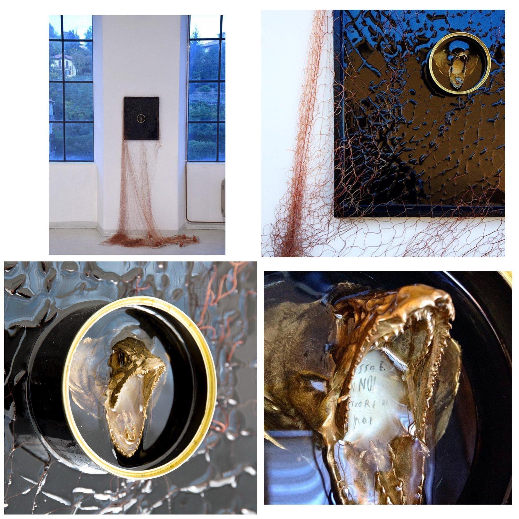 Elisa Baldissera - Overfishing #2 - Tecnica mista (testa di pesce, scritta su carta, rete da pesca, latta di tonno, resina epossidica, vernici) - 42 X 54 cm. (più rete) - 2017